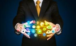Businessman holding app icon cloud Stock Image