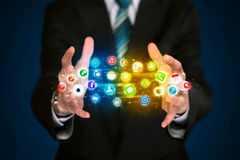 Businessman holding app icon cloud Stock Images