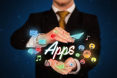 Businessman holding apps Royalty Free Stock Photo