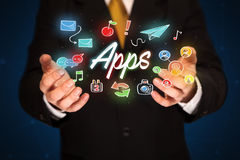 Businessman holding apps Stock Photo