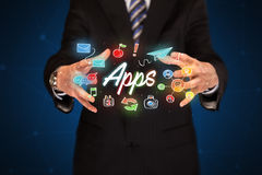 Businessman holding apps Stock Photos
