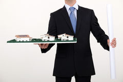 Businessman holding an architectural model Royalty Free Stock Photo