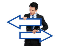Businessman holding arrow in hand Stock Image