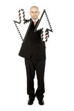 Businessman holding arrows Stock Photography