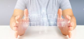 Businessman holding an artificial inteligence robot made of ligh royalty free stock photo