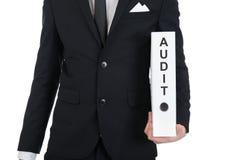 Businessman holding audit folder Stock Image