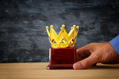 Businessman holding award trophy for show victory or winning first place Royalty Free Stock Photos