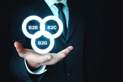 Businessman holding B2B, B2C, B2G business models. Business concept royalty free stock photography