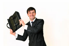 Businessman holding a bag. Smiling isolated on white background Royalty Free Stock Image