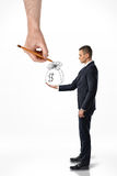 Businessman holding bag of money with big hand that draws it Stock Image