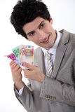 Businessman holding bank notes Royalty Free Stock Photography