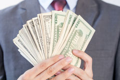 Businessman holding bank notes in white  background Royalty Free Stock Image