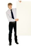 Businessman holding banner add. Young businessman holding blank poster Stock Image