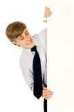 Businessman holding banner add. Young businessman holding blank poster Royalty Free Stock Image