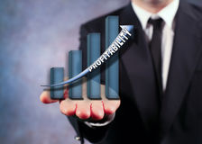 Businessman Holding Bar Graph. Businessman Displaying Virtual Profitability Bar Graph on His Outstretched Hand Royalty Free Stock Image