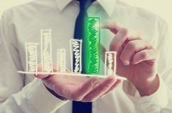 Businessman holding a bar graph in his hand Royalty Free Stock Image