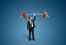 Businessman holding barbell Royalty Free Stock Images
