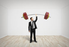 Businessman holding barbell Stock Photo