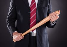 Businessman holding baseball bat Stock Image