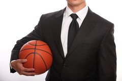 Businessman holding a basketball Stock Photos