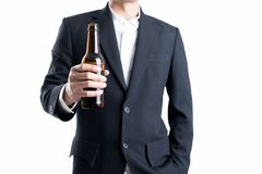 Businessman holding a beer bottle on isolated white background. stock photo