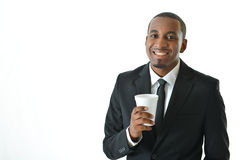 Businessman Holding Beverage. Business man holding a beverage and smiling Stock Photos
