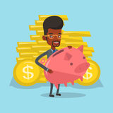 Businessman holding a big piggy bank. Royalty Free Stock Photography