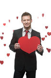 Businessman holding big red heart Royalty Free Stock Image