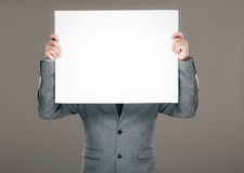 Businessman holding billboard Stock Images