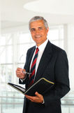 Businessman Holding Binder and Glasses Stock Image