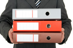 Businessman Holding Binders Stock Photography