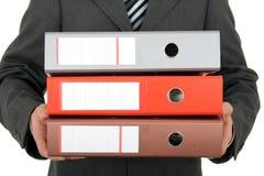 Businessman Holding Binders Stock Photography