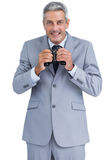 Businessman holding binoculars in both hands Royalty Free Stock Photo