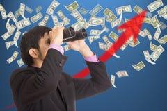 Businessman holding binoculars Stock Image