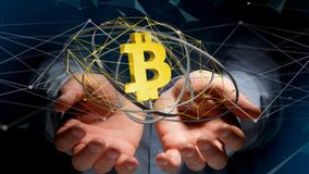 Businessman holding a Bitcoin crypto currency sign flying around. View of a Businessman holding a Bitcoin crypto currency sign flying around a network connection Royalty Free Stock Photo