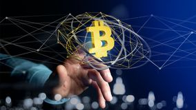 Businessman holding a Bitcoin crypto currency sign flying around. View of a Businessman holding a Bitcoin crypto currency sign flying around a network connection Stock Image