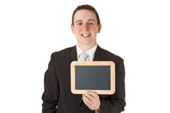 Businessman holding a black board Royalty Free Stock Image