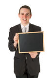Businessman holding a black board Royalty Free Stock Photo