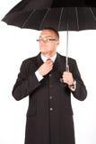 Businessman  holding black umbrella Stock Photography