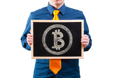 Businessman holding a blackboard with bitcoin symbol Stock Image