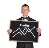 Businessman holding a blackboard Royalty Free Stock Images