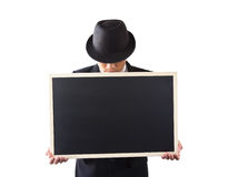 Businessman holding a blackboard. Stock Photos