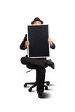 Businessman holding a blackboard. Royalty Free Stock Images