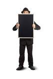 Businessman holding a blackboard. Stock Photo