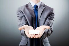 Businessman holding blank Stock Image