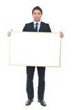 Businessman holding blank banner stock photos