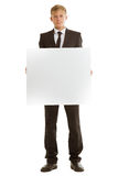 Businessman holding blank banner Stock Photography