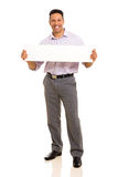 Businessman holding blank banner Royalty Free Stock Image
