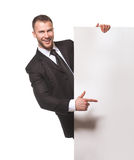 Businessman holding blank billboard Stock Images