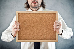 Businessman holding blank bulletin board Royalty Free Stock Photos